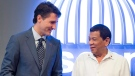 Canadian Prime Minister Justin Trudeau, left, speaks with Philippines President Rodrigo Duterte as he arrives at the opening ceremony for Association of Southeast Asian Nations in Manila, Philippines on Monday, November 13, 2017. THE CANADIAN PRESS/Adrian Wyld