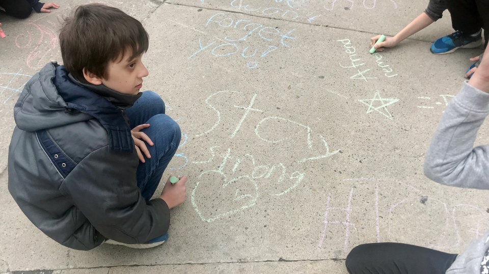 Piece of chalk have been left on the west Yonge Street sidewalk for passersby to write messages of hope and support on the one-year anniversary. (Danny Pinto/CTV News Toronto)