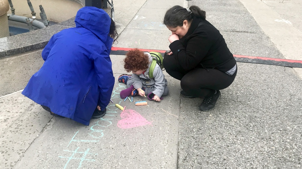 Messages of support and strength cover the sidewalk on Yonge Street in Willowdale on April 23, 2019.