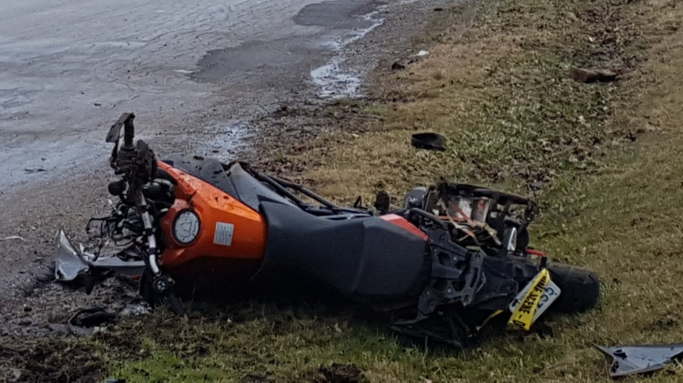 A motorcycle lays on the ground after a crash that left its rider with life-threatening injuries. (@OPP_WR / Twitter)