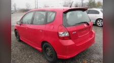 A red Honda fit