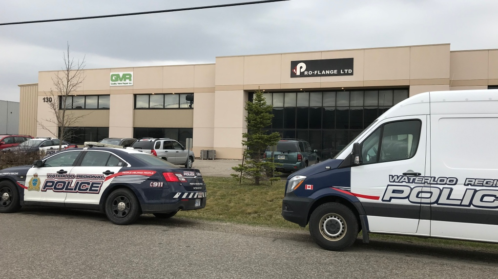 Police vehicles in front of a business