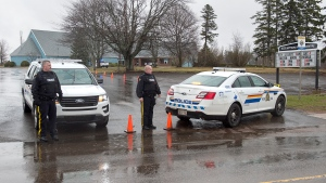 Police officers guard the entrance to the Assumption Parish Centre in Stratford, P.E.I. on Tuesday, April 23, 2019. Authorities received a threat to the polling station and Elections PEI has suspended voting until it is safe to return to the premises. (THE CANADIAN PRESS/Andrew Vaughan)