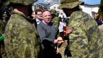 Quebec Premier Francois Legault speaks to Canadian Forces members filling sandbags as he visits a flooded area on Rue Saint-Louis in Gatineau, Que., on Monday, April 22, 2019. THE CANADIAN PRESS/Justin Tang