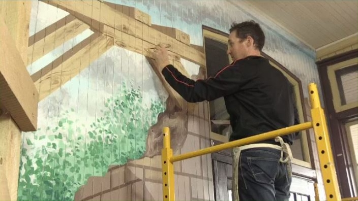 Geoff Slater paints a diorama at the McAdam train station that will showcase the efforts of Canadian Pacific Railway workers during the First World War.