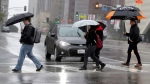 In this Monday, Feb. 6, 2017 file photo, pedestrians cross a rainy street in downtown Los Angeles. (AP Photo/Nick Ut)