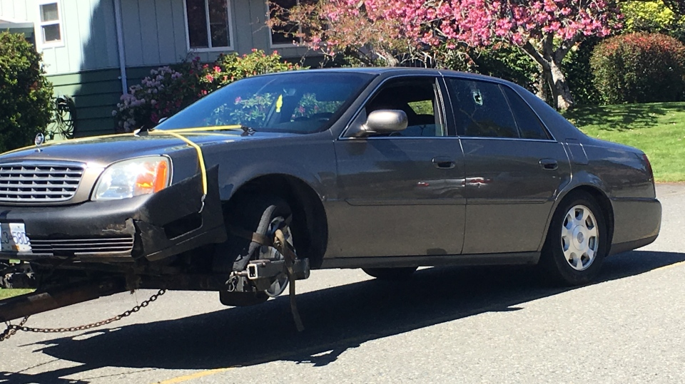 A car with a hole in its window is towed from Leila Place in Langford Tues., April 23, 2019. (CTV Vancouver Island)