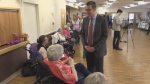 Lambton Kent Middlesex MPP Monte McNaughton, Infrastructure Minister, talks to a senior on Tuesday, April 23, 2019 in Strathroy, Ont., where he announced new long-term care beds for the area.