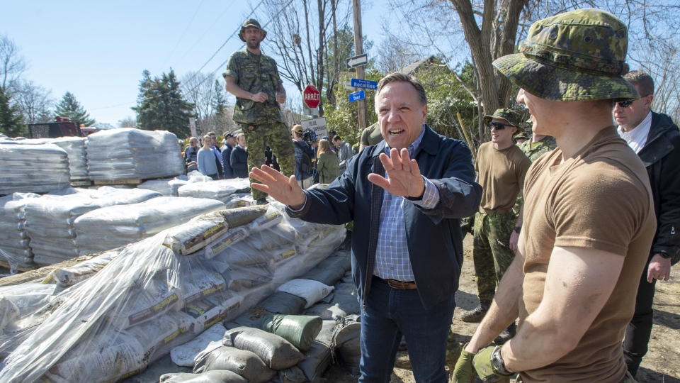 Quebec Premier Francois Legault thanks Canadian Forces personnel as they reinforce a dike against rising flood waters Sunday, April 21, 2019 in Laval, Que. THE CANADIAN PRESS/Ryan Remiorz