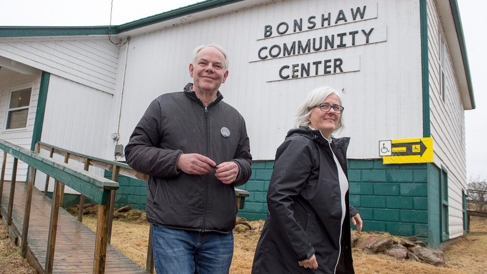 Peter Bevan-Baker, leader of the Green party, and his wife Ann head from the voting place after voting in the Prince Edward Island provincial election in Bonshaw, P.E.I. on Tuesday, April 23, 2019. (THE CANADIAN PRESS/Andrew Vaughan)