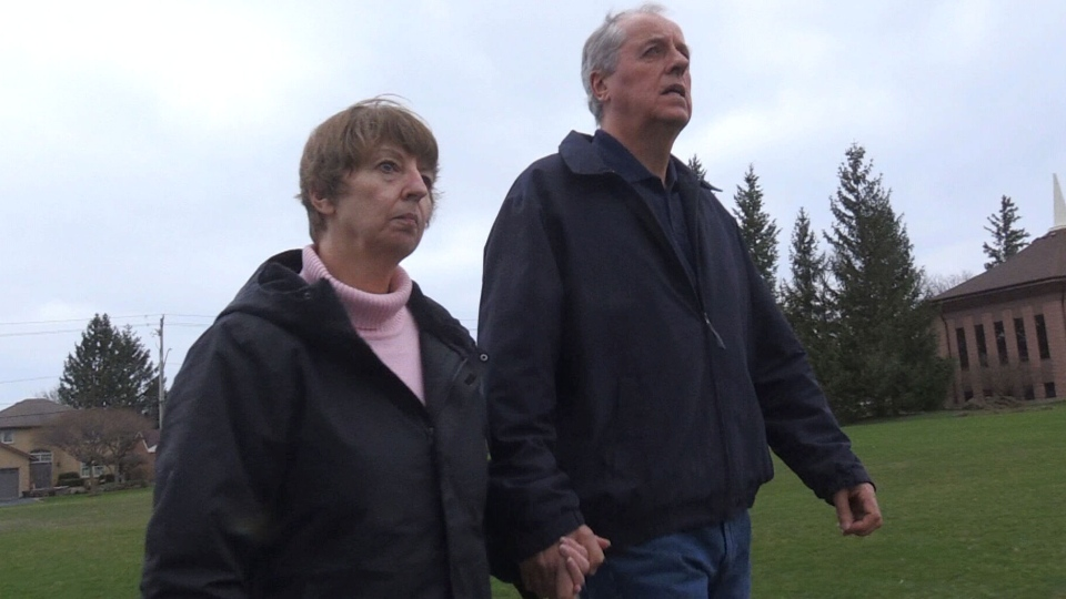 Gail Jardine and her husband walk in their neighbourhood in Kitchener, Ont. The effects of Parkinson's disease left Jardine unable to walk safely on her own, but an implanted electrical stimulator is helping her regain that mobility.