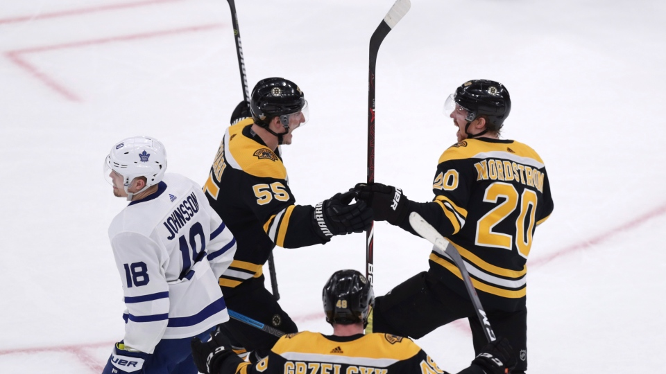 Boston Bruins center Joakim Nordstrom (20) is congratulated by Noel Acciari (55) after his goal against the Toronto Maple Leafs during the first period of Game 7 of an NHL hockey first-round playoff series, Tuesday, April 23, 2019, in Boston. (AP Photo/Charles Krupa)