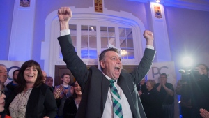 Progressive Conservative leader Dennis King, accompanied by his wife Jana Hemphill, left, arrives to greet supporters after winning the Prince Edward Island provincial election in Charlottetown on Tuesday, April 23, 2019. THE CANADIAN PRESS/Andrew Vaughan