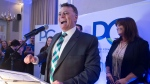 Progressive Conservative leader Dennis King, accompanied by his wife Jana Hemphill, right, addresses supporters after winning the Prince Edward Island provincial election in Charlottetown on Tuesday, April 23, 2019.  THE CANADIAN PRESS/Andrew Vaughan