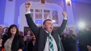 Progressive Conservative leader Dennis King, accompanied by his wife Jana Hemphill, left, arrives to greet supporters after winning the Prince Edward Island provincial election in Charlottetown on Tuesday, April 23, 2019. The Progressive Conservatives will form a minority government with the Green party as the opposition. (THE CANADIAN PRESS/Andrew Vaughan)
