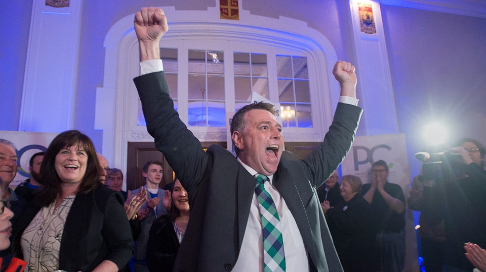 Progressive Conservative leader Dennis King, accompanied by his wife Jana Hemphill, left, arrives to greet supporters after winning the Prince Edward Island provincial election in Charlottetown on Tuesday, April 23, 2019.  (THE CANADIAN PRESS/Andrew Vaughan)