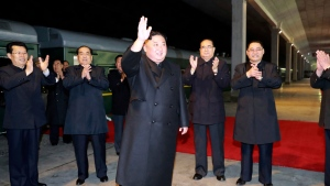 In this photo provided by the North Korean government, North Korean leader Kim Jong Un waves at an undisclosed train station in North Korea Wednesday, April 24, 2019, before leaving for Russia. (Korean Central News Agency/Korea News Service via AP)