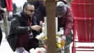Omar Hassan arranges flowers left at a plaque in Toronto's Mel Lastman Square on Tuesday April, 23, 2019 to to commemorate last year's van attack which left 10 people dead. Hassan maintained a makeshift memorial for 40 days after the attack. THE CANADIAN PRESS/Chris Young