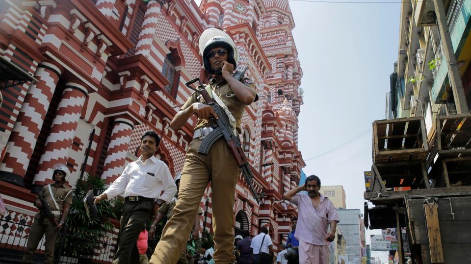 A Sri Lankan police officer patrols out side a mosque in Colombo, Sri Lanka, Wednesday, April 24, 2019. (AP Photo/Eranga Jayawardena)