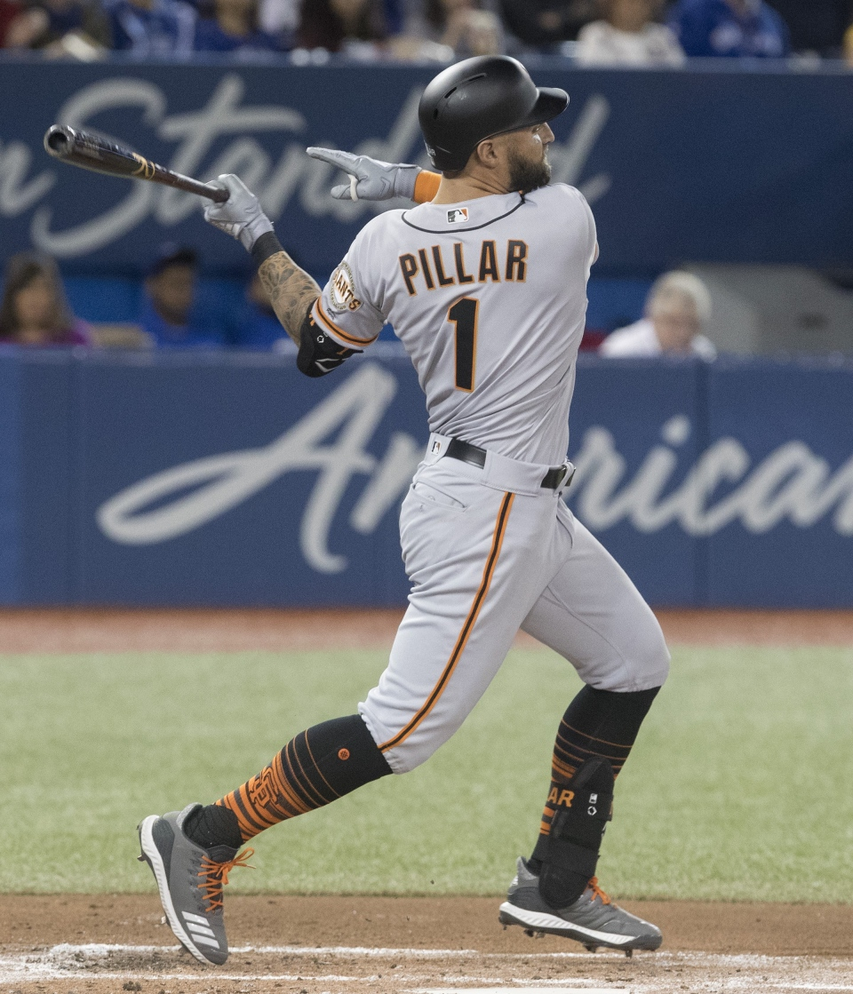 San Francisco Giants Kevin Pillar, formerly with the Blue Jays, hits a single to drive in a run in his first at bat in the second inning of their Interleague MLB baseball game in Toronto Tuesday April 23, 2019. THE CANADIAN PRESS/Fred Thornhill