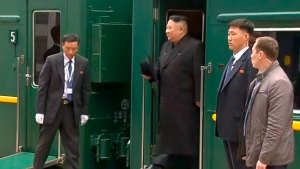 In this image taken from the RU-RTR Russian television, North Korean leader Kim Jong Un smiles as he leaves a train in Vladivostok railway station in Vladivostok, Russia, Wednesday, April 24, 2019. (RU-RTR Russian Television via AP)