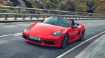 This undated photo provided by Porsche shows the 2019 Porsche 718 Boxster, one of the best sports cars on sale today. The mid-engine design gives it balanced handling around corners, while turbocharged four-cylinder engines provide plenty of thrust. (Courtesy of Porsche Cars North America via AP)