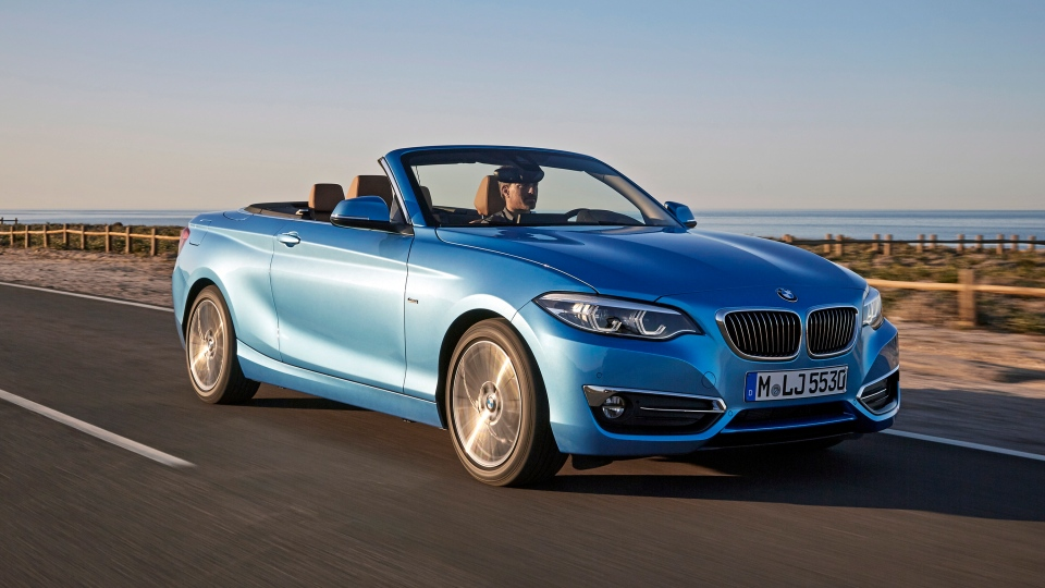 This photo provided by BMW shows the 2019 BMW 2 Series, the smallest and least expensive of BMW's convertibles. It's also one of the best thanks to a luxurious interior, excellent handling characteristics, and a choice between two thrilling turbocharged engines. (Courtesy of BMW of North America via AP)