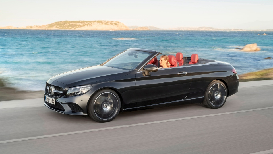 This undated photo provided by Mercedes-Benz shows the 2019 Mercedes-Benz C-Class, one of our favorite entry-level luxury convertibles. This sporty ride is complemented by rich, upscale cabin materials, and scores of available luxury features. (Courtesy of Mercedes-Benz USA via AP)