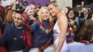 Brie Larson takes a selfie with a fan at the premiere of 'Avengers: Endgame' in L.A. on April 22, 2019. (Chris Pizzello / Invision / AP)