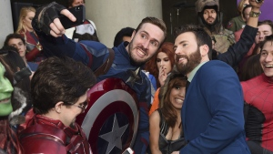 Chris Evans takes a selfie with a fan