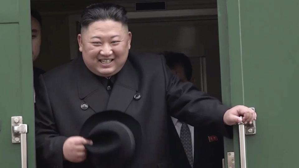 Kim Jong Un smiles as he leaves Khasan train station in Primorye region, Russia, on April 24, 2019. (Primorsky Regional Administration Press Service via AP)