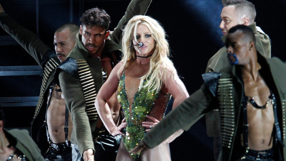 In this June 13, 2017, file photo, U.S. singer Britney Spears performs during her concert in Taipei, Taiwan. Spears has decided to focus on self-care as she goes through a rough stretch. (AP Photo/Chiang Ying-ying, File)