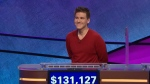 "This file image made from video and provided by Jeopardy Productions, Inc. shows ""Jeopardy!"" contestant James Holzhauer on an episode that aired on April 17, 2019. On his 14th appearance Tuesday, April 23, 2019, Holzhauer eclipsed the $1 million mark in winnings. (Jeopardy Productions, Inc. via AP)"