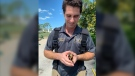Bonita Springs firefighter Elliot Wilson was praised for leaning upside down for several minutes at a time to pluck stranded ducklings from a storm drain at the Spanish Wells Golf and Country Club in Florida. (Facebook/Bonita Springs Fire Control and Rescue District)