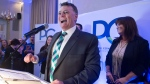 Progressive Conservative leader Dennis King, accompanied by his wife Jana Hemphill, right, addresses supporters after winning the Prince Edward Island provincial election in Charlottetown on Tuesday, April 23, 2019.  (THE CANADIAN PRESS/Andrew Vaughan)