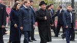In this photo released by the Press office of the administration of Primorsky Krai region, North Korea's leader Kim Jong Un, center, surrounded by Russian and North Korea's officials walks, after arriving in Vladivostok, Russia, Wednesday, April 24, 2019. North Korean leader Kim Jong Un arrived in Russia on Wednesday morning for his much-anticipated summit with Russian President Vladimir Putin in the Pacific port city of Vladivostok. (Igor Novikov/Press Office of the Primorye Territory Administration via AP)