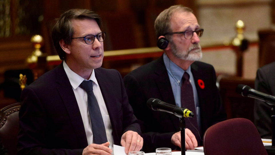 Stephane Perrault, (left) Chief Electoral Officer of Canada, and Yves Cote, Commissioner of Canada Elections, appear as witness for a Committee of the Whole regarding Bill C-76 (Elections Modernization Act) in the Senate on Parliament Hill in Ottawa on Tuesday, Nov. 6, 2018.THE CANADIAN PRESS/Sean Kilpatrick
