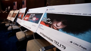 In this Nov. 1, 2017, file photo, Facebook ads linked to a Russian effort to disrupt the American political process are displayed. (AP Photo/Manuel Balce Ceneta, File)