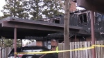 Woman hospitalized following townhouse fire
