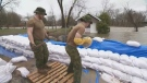 Soldiers stack sandbags to reinforce a dike in Saint André d'Argenteuil on Wednesday April 24, 2019