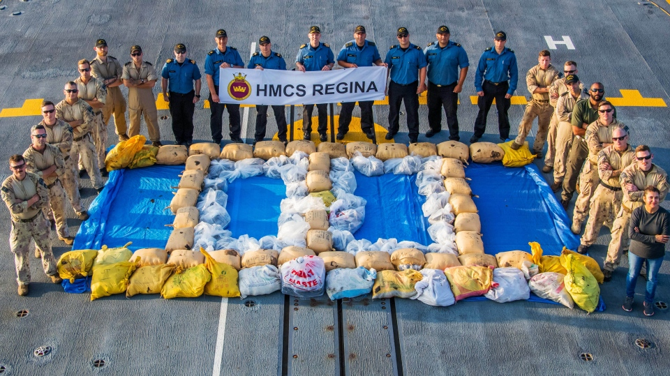 Members of the HMCS Regina pose with drugs seized on April 18, 2019. (Department of National Defence)