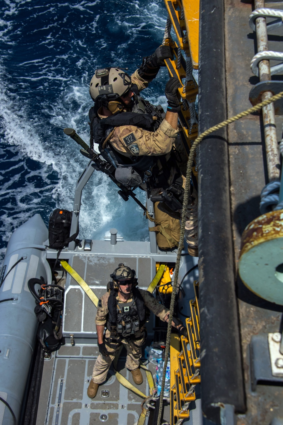 The Naval Tactical Operations Group prepares to board a suspect vessel in the Arabian Sea. (Department of National Defence)