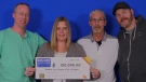 Left to right: Jeff, Heather, Dan and Ryan, holding their OLG winnings. (Source: OLG)