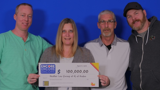 Four people posing with their OLG cheque