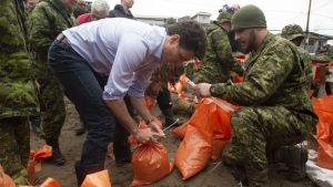 Prime Minister Justin Trudeau helps members of the Canadian Forces fill sandbags Wednesday April 24, 2019 in Gatineau, Que. THE CANADIAN PRESS/Adrian Wyld