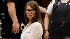 Anna Sorokin sits at the defense table during her trial at New York State Supreme Court, in New York, Wednesday, April 24, 2019. Sorokin, who claimed to be a German heiress, is on trial on grand larceny and theft of services charges. (AP Photo/Richard Drew)