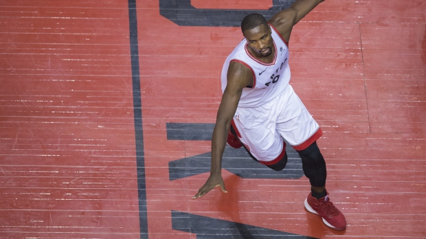 Toronto Raptors centre Serge Ibaka (9) reacts after a slam-dunk against the Orlando Magic during second half NBA playoff basketball action in Toronto, on Tuesday, April 23, 2019. THE CANADIAN PRESS/Nathan Denette