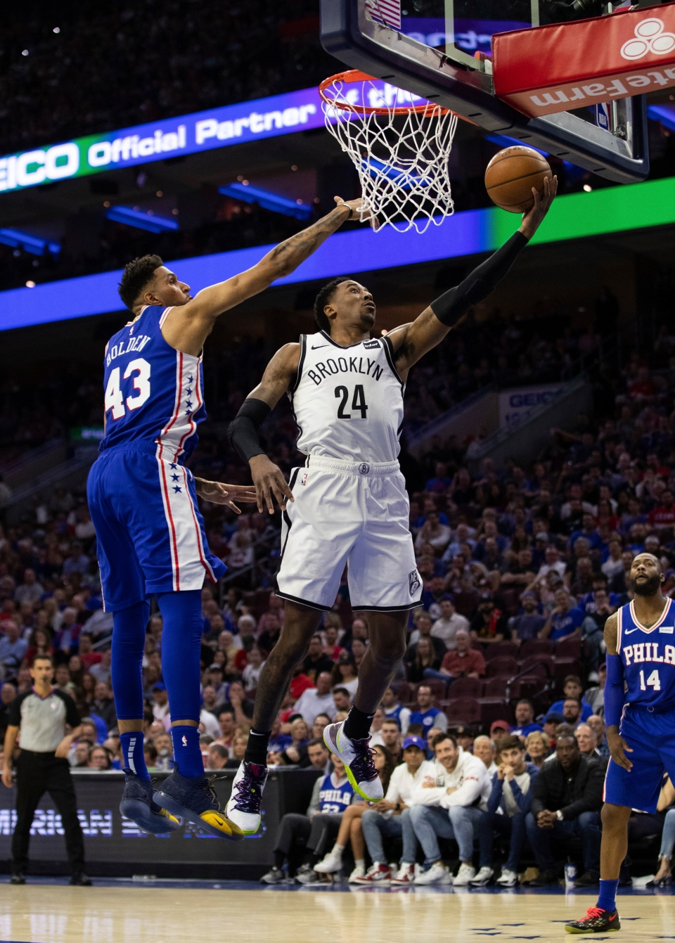Brooklyn Nets' Rondae Hollis-Jefferson (24) goes up for the shot against Philadelphia 76ers' Jonah Boldens, left, of Australia, during the second half in Game 5 of a first-round NBA basketball playoff series, Tuesday, April 23, 2019, in Philadelphia. The 76ers won 122-100. (AP Photo/Chris Szagola)