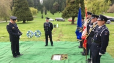 Two wreaths were laid beside Kirby's headstone at the Royal Oak Burial Park. (CTV Vancouver Island)
