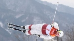 Andi Naude of Penticton, B.C. jumps during a women's freestyle moguls qualification run at the Phoenix Snow Park at the Pyeongchang 2018 Winter Olympic Games in South Korea, Friday, Feb. 9, 2018. (Jonathan Hayward / THE CANADIAN PRESS)